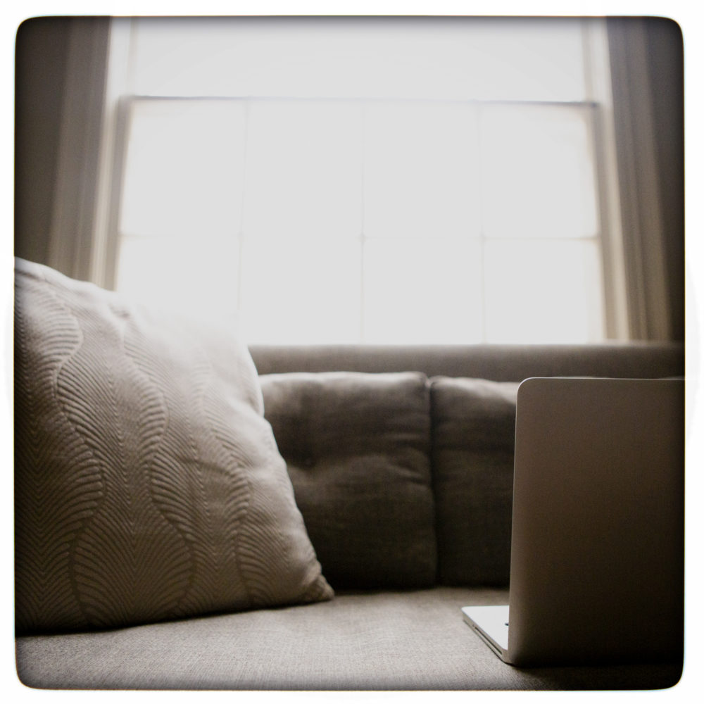 laptop sitting on a couch