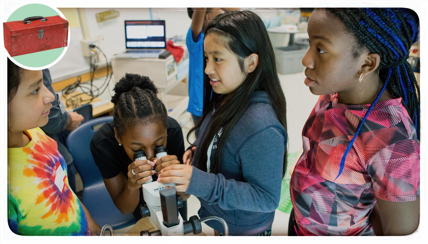 girls using a microscope