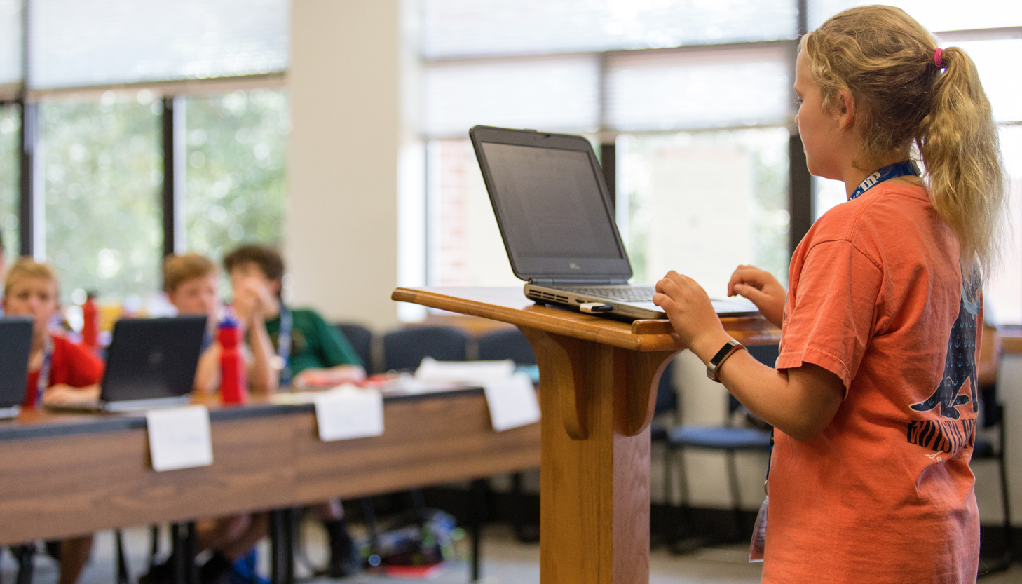 girl giving a class presentation