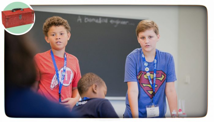 two boys giving a classroom presentation
