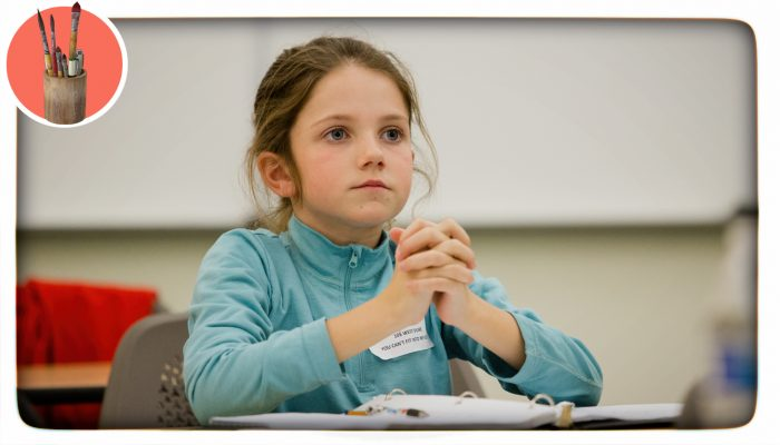 a girl sitting quietly in class