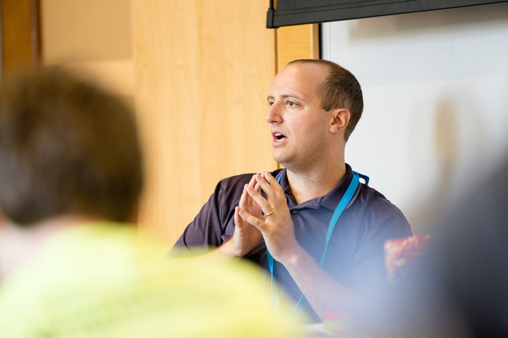 teacher leading a classroom discussion